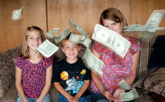 kids money dollar bills tossed by  Carissa Rogers, (CC BY 2.0)